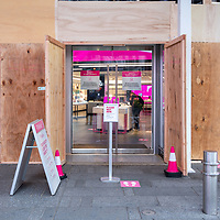 A boarded-up T-Mobiel store in anticipation of post-election day violence in Times Square New York, USA.