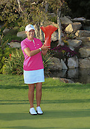 29 MAR15 Christie Kerr hold the glassware at the conclusion of Sunday's Final Round of The KIA Classic at Aviara Golf Club in LaCosta, California. (photo credit : kenneth e. dennis/kendennisphoto.com)