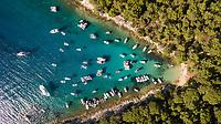 Aerial view of boats anchored at the shore of Otok Koludarc island, Croatia.