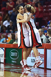25 March 2010: Near the end of the game, starters Ashleen Bracey and Amanda Clifton embrace in jubilee. The Redbirds of Illinois State crush the Jayhawks of Kansas 71-51 during the 3rd round of the 2010 Women's National Invitational Tournament (WNIT) on Doug Collins Court inside Redbird Arena at Normal Illinois.