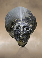 Hittite statue head of the Sun Goddess . Basalt, Hittie Period 1650 - 1450 BC. Hattusa Boğazkale. Çorum Archaeological Museum, Corum, Turkey. Against a warm art bacground. .<br />  <br /> If you prefer to buy from our ALAMY STOCK LIBRARY page at https://www.alamy.com/portfolio/paul-williams-funkystock/hittite-art-antiquities.html  - Type Hattusa into the LOWER SEARCH WITHIN GALLERY box. Refine search by adding background colour, place,etc<br /> <br /> Visit our HITTITE PHOTO COLLECTIONS for more photos to download or buy as wall art prints https://funkystock.photoshelter.com/gallery-collection/The-Hittites-Art-Artefacts-Antiquities-Historic-Sites-Pictures-Images-of/C0000NUBSMhSc3Oo