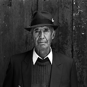 Saturnino Rivadineira Torrez, 79, retired. Potosi. Bolivia..Sitting at 4,090M (13,420 Feet) above sea level the small mining community of Potosi, Bolivia is one of the highest cities in the world by elevation and sits ?sky high? in the hills of the land locked nation. Overlooking the city is the infamous mountain, Cerro Rico (rich mountain), a mountain conceived to be made of silver ore. It was the major supplier of silver for the spanish empire and has been mined since 1546, according to records 45,000 tons of pure silver were mined from Cerro Rico between 1556 and 1783, 9000 tons of which went to the Spanish Monarchy. The mountain produced fabulous wealth and became one of the largest and wealthiest cities in Latin America. The Extraordinary riches of Potosi were featured in Maguel de Cervantes famous novel Don Quixote. One theory holds that the mint mark of Potosi, the letters PTSI superimposed on one another is the origin of the dollar sign. Today mainly zinc, lead, tin and small quantities of silver are extracted from the mine by over 100 co-operatives and private mining companies who still mine the mountain in poor working conditions, children are still used in the mines and the lack of protective equipment and constant inhalation of dust means miners have a short life expectancy with many contracting silicosis and dying around 40 years of age. UNESCO designated the historic city a World Heritage site in 1987. Most of Potosí's colonial churches have been restored, and tourism has increased. Potosi, Bolivia. 16th September 2011. Photo Tim Clayton
