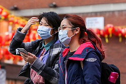 © Licensed to London News Pictures. 01/02/2020. London, UK. Asian women are seen in London's Chinatown wearing face masks following the outbreak of Coronavirus in Wuhan, China. <br /> According to the Department of Health, 203 people have been tested in the UK, with 201 results coming back negative and two positive. One of the two people to test positive for is a student at the University of York. Photo credit: Dinendra Haria/LNP