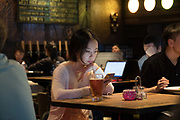 Girl in cyber cafe restaurant bar in Shanghai French Concession. China