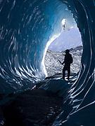 Katie Borthwick exploring ice cave within the Matanuska Glacier, Glacier View, Alaska.