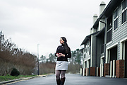 """BIRMINGHAM, AL – FEBRUARY 16, 2018: Anna Lewis, 25, stands outside the sober living apartment where she is in recovery for alcohol addiction. <br /> <br /> As a teenager, Lewis first encountered opiates through pain medication that was prescribed to her after a car accident in high school. Oxycontin, the social drug of choice at the time, was so prevalent in her hometown of Pensacola, Fla., that experimentation was easy. """"I didn't even have to look for it. It was just there – at my work, or my friends had it,"""" she said. """"I didn't realize I was addicted until I felt like I had the flu one day, and after using, I felt normal. That's when I knew I had a problem."""" Within a year, Lewis had switched to shooting heroine, and even moved to Atlanta where the drug was cheaper and easier to find. It took an arrest for possession while shoplifting books at a Barnes & Noble to finally realize she was an addict. """"I'd spent all my money on dope,"""" Lewis said. """"So those books were my friends. It's hard to have real friends when you're using. Dope is your priority. The people you're around are sick too, so no one is looking out for you. Everyone's focus is dope."""" At age 19, Lewis finally kicked the heroine habit after checking herself into a detox program, but she soon turned to alcohol. """"It only took about a year for me to become an alcoholic – needing it on a daily basis,"""" she said. Today, Lewis has been sober from alcohol for 3 months, but she says she's painfully aware of the money her mother and grandmother have spent on rehab, and has felt obligated to pay back what she can. """"My mom has always been there for me, and she still is,"""" Lewis said. """"It's been life saving to know that I'm able to call her anytime, and there will be love on the other end of the line."""" <br /> <br /> The addiction crisis that is killing tens of thousands of Americans every year is also creating a financial crisis for many families, compounding the anguish caused by a loved"""