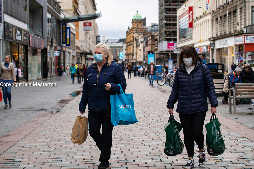 Glasgow, Scotland, UK. 26 October 2020. View of Glasgow city centre on weekday during circuit breaker lockdown with bars and restaurants closed. Pictured; Shoppers wearing facemasks on Argyle Street. . Iain Masterton/Alamy Live News
