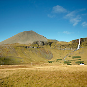 Icelandic countryside scenery with farm and waterfall