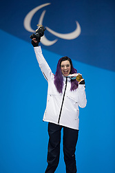 March 12, 2018 - Pyeongchang, South Korea - Brenna Huckaby of the US celebrates her gold medal win in Women's Snowboard Cross during a Medal Ceremony Monday, March 12, 2018 at the Medals Plaza for the 2018 Pyeongchang Winter Paralympic Games. Photo by Mark Reis (Credit Image: © Mark Reis via ZUMA Wire)