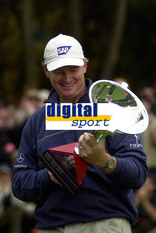 © Peter Spurrier/Sportsbeat Images <br />Tel +441494783165 email images@sbimages.co.uk<br />19/10/2003 - Photo  Peter Spurrier<br />2003 HSBC World Match Play Championship - Wentworth<br />Sunday - Final Day- Ernie Els v Thomas Bjorn:<br />Ernie Els checks the torphy over after winning on the 14th of the afternoon round.