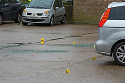 © Licensed to London News Pictures. 29/10/2020. Aylesbury, UK. Police evidence identification markers and broken glass inside the cordoned crime scene. Thames Valley Police have launched a murder investigation following an incident in Aylesbury. At approximately 21:30GMT on Wednesday 28/10/2020 police officers were called to Lembrook Walk, Aylesbury not far from the Edinburgh Playing Fields following reports that two men had been assaulted. A man in his twenties was taken to hospital with serious injuries where he later died. Photo credit: Peter Manning/LNP