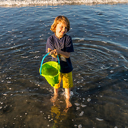 A young boy plays at Seapoint Beach in Kittery, Maine.