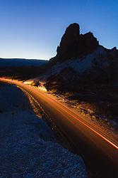 Automobile headlights and taillights on Ross Maxwell Road near Cerro Castelon, Big Bend National Park, Texas, USA.