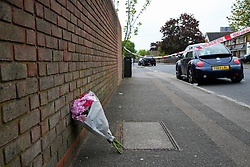 © Licensed to London News Pictures. 27/04/2020. London, UK. Flowers left at a crime scene on Freemasons Road in Newham, East London. Police launch a murder investigation following stabbing of a man in his mid-20s. Police were called after 10.30pm on Sunday 26 April to Lambert Road in Newham. Photo credit: Dinendra Haria/LNP