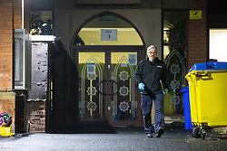 © Licensed to London News Pictures. 11/09/2021. Manchester, UK. An investigator from the fire service is seen examining the scene . Police and firefighters attend at Didsbury Mosque in South Manchester , shortly after midnight tonight ( Saturday 11th September )in what is understood to be the scene of an attempted arson attack . Photo credit: Joel Goodman/LNP