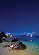 A family relaxes on vacation at a beautiful carribean beach