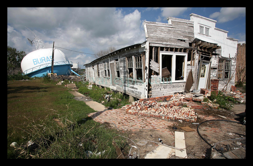 May 2nd, 2006. Plaquemines Parish just south of New Orleans, Louisiana. Over 8 months after hurricane Katrina and still the parish remains in ruins. Desolate buildings with graffiti sprayed on the walls. A collapsed water tower in the back yard.