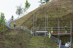 Construction workers wearing high-visibility clothing make final preparations to the Marble Arch Mound on 24th July 2021 in London, United Kingdom. The Marble Arch Mound, a tourist attraction which is expected to offer views across Central London and Hyde Park, is due to open on 26th July.