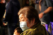 portrait of a senior Japanese woman wearing a breathing mask