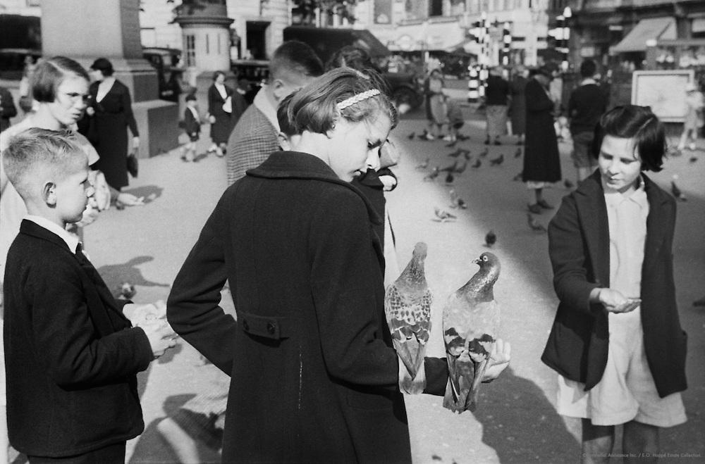 People Feeding Pigeons, London, c.1935