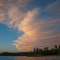 A sunset glows over islands in Lake of the Woods, Ontario, Canada.
