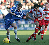 Photo: Dave Howarth.<br />Oldham Athletic v Doncaster Rovers. Coca Cola League 1.<br />13/11/2005.  Oldham's Chris Porter and Doncaster's Michael McIndoe get to grips with each others shirts