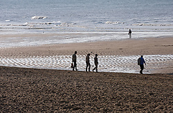Visitors and residents walk on the beach in Ostend, Belgium, Sunday, Sept. 14, 2008. (Photo © Jock Fistick)