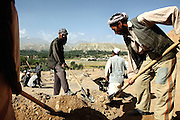 Afghan labourers are employed by Professor Zemaryali Tarzi, a notable An Afghan-born archaeologist from France and teacher in Strasbourg University, while on his hunt for a legendary 300m Sleeping Buddha statue between the original standing Buddhas of Bamiyan, Afghanistan, as documented in the old account of a renowned Chinese scholar, Xuanzang, visiting the area in the 7th century. The Buddhas of Bamiyan were two 6th century monumental statues of standing Buddhas carved into the side of a cliff in the Bamiyan valley in the Hazarajat region of central Afghanistan, situated 230 km northwest of Kabul at an altitude of 2500 meters. The statues represented the classic blended style of Gandhara art. The main bodies were hewn directly from the sandstone cliffs, but details were modelled in mud mixed with straw, coated with stucco. Amid widespread international condemnation, the smaller statues (55 and 39 meters respectively) were intentionally dynamited and destroyed in 2001 by the Taliban because they believed them to be un-Islamic idols. Once a stopping point along the Silk Road between China and the Middle East, researchers think Bamiyan was the site of monasteries housing as many as 5,000 monks during its peak as a Buddhist centre in the 6th and 7th centuries. It is now a UNESCO Heritage Site since 2003. Archaeologists from various countries across the world have been engaged in preservation, general maintenance around the site and renovation. Professor Tarzi worked on projects to restore the other Bamiyan Buddhas in the late 1970s and has spent most of his career researching the existence of the missing giant Buddha in the valley.