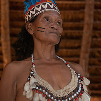 An Amazon Indian woman of the Bora tribe near Iquitos, Peru, prepares to dance for tourists - perhaps a sideline to a more modern, workaday job.