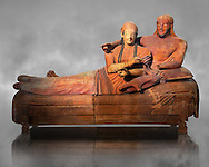 6th century BC Etruscan Sarcophagus known as The Sarcophagus of the Spouses, the in sculpted in clay by the sculptors of Caere, 520-510 BC, Louvre Museum, Paris.   Grey art Background. To license for non editorial Advertising usage contact The Louvre Paris .<br /> <br /> If you prefer to buy from our ALAMY PHOTO LIBRARY  Collection visit : https://www.alamy.com/portfolio/paul-williams-funkystock/vatican-museums-etruscan.html - Type -       Louvre     - into the LOWER SEARCH WITHIN GALLERY box.<br /> <br /> Visit our ETRUSCAN PHOTO COLLECTIONS for more photos to download or buy as wall art prints https://funkystock.photoshelter.com/gallery-collection/Pictures-Images-of-Etruscan-Historic-Sites-Art-Artefacts-Antiquities/C0000GgxRXWVMLyc