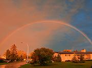 Rainbow after storm  in city neighbourhood<br />Winnipeg<br />Manitoba<br />Canada