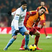 Galatasaray's Selcuk Inan (R) and Trabzonspor's Gustavo Colman (L) during their Turkish superleague soccer derby match Galatasaray between Trabzonspor at the AliSamiYen spor kompleksi TT Arena in Istanbul Turkey on Sunday, 22 December 2013. Photo by TURKPIX