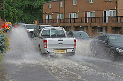 © Licensed to London News Pictures 20/07/2021. Orpington, UK. Heatwave thunderstorms hit Orpington in South East London causing roads to flood and drains to <br /> overflow. Photo credit:LNP