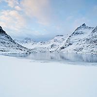 Partially frozen lake Ågvatnet in winter, Å I Lofoten, Lofoten Islands, Norway