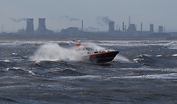 © Licensed to London News Pictures. <br /> 01/02/2015. <br /> <br /> South Gare, Redcar, United Kingdom<br /> <br /> The Pilot boat from Teesport approaches the container ship Wilhelmine as it approaches the mouth of the Tees at South Gare near Redcar in Teesside.<br /> <br /> Photo credit : Ian Forsyth/LNP