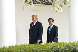 US President Donald J. Trump (L) and Korean President Moon Jae-in (R) walk along the Colonnade of the White House in Washington, DC, USA, 11 April 2019. President Moon is expected to ask President Trump to reduce sanctions on North Korea in an attempt to jump start nuclear negotiations between North Korea and the US.