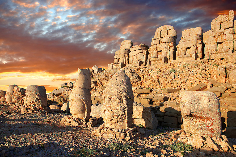 Pictures of the statues of around the tomb of Commagene King Antochus 1 on the top of Mount Nemrut, Turkey. Stock photos & Photo art prints. In 62 BC, King Antiochus I Theos of Commagene built on the mountain top a tomb-sanctuary flanked by huge statues (8–9 m/26–30 ft high) of himself, two lions, two eagles and various Greek, Armenian, and Iranian gods. The photos show the broken statues on the  2,134m (7,001ft)  mountain. 5 .<br /> <br /> If you prefer to buy from our ALAMY PHOTO LIBRARY  Collection visit : https://www.alamy.com/portfolio/paul-williams-funkystock/nemrutdagiancientstatues-turkey.html<br /> <br /> Visit our CLASSICAL WORLD HISTORIC SITES PHOTO COLLECTIONS for more photos to download or buy as wall art prints https://funkystock.photoshelter.com/gallery-collection/Classical-Era-Historic-Sites-Archaeological-Sites-Pictures-Images/C0000g4bSGiDL9rw