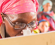 Photo Randy Vanderveen<br /> Nyamirimirwa, Musanze District, Rwanda<br /> 2015-05-27<br /> An adult literacy class, which is geared mostly to woman but has several men participants, is a year long and graduates are given a certificate and kinyrwandan bible so they can continue to practise the skills they learned. Some of the participants will eventually go back to primary school to continue their education while others take on leadership roles in their community because of their newly acquired literacy skills. Students who graduate are given a Bible in their own language and a certificate.