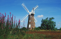 View of windmill in countryside,