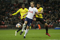 BRITAIN-LONDON-FOOTBALL-PREMIER LEAGUE-TOTTENHAM HOTSPUR VS WATFORD.(180430) -- LONDON, April 30, 2018  Tottenham Hotspur's Harry Kane (C)  competes for the ball with Watford's Abdoulaye Doucouré (L) and Watford's Adrian Mariappa during the Premier League football match between Tottenham Hotspur and Watford at Wembley Stadium in London, Britain on April 30, 2018.  Tottenham Hotspur won 2-0.  FOR EDITORIAL USE ONLY. NOT FOR SALE FOR MARKETING OR ADVERTISING CAMPAIGNS. NO USE WITH UNAUTHORIZED AUDIO, VIDEO, DATA, FIXTURE LISTS, CLUB/LEAGUE LOGOS OR ''LIVE'' SERVICES. ONLINE IN-MATCH USE LIMITED TO 45 IMAGES, NO VIDEO EMULATION. NO USE IN BETTING, GAMES OR SINGLE CLUB/LEAGUE/PLAYER PUBLICATIONS. (Credit Image: © Tim Ireland/Xinhua via ZUMA Wire)