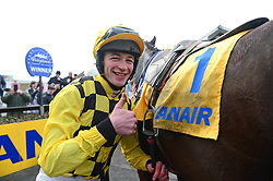 Jockey David Mullins celebrates winning the Ryanair Gold Cup Novice Chase on Al Boum Photo during Ryan Air Gold Cup Day of the 2018 Easter Festival at Fairyhouse Racecourse, Ratoath, Co. Meath.