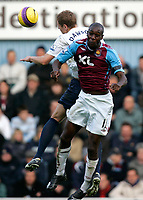 Photo: Tom Dulat/Sportsbeat Images.<br /> <br /> West Ham United v Tottenham Hotspur. The FA Barclays Premiership. 25/11/2007.<br /> <br /> Carlton Cole of West Ham United and Michael Dawson of Tottenham Hotspur head for the ball.
