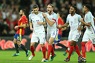 GOAL - Adam Lallana of England (l) celebrates after scoring his sides 1st goal from a penalty with his teammates Jordan Henderson, the England captain (8) and Raheem Sterling of England. England v Spain, Football international friendly at Wembley Stadium in London on Tuesday 15th November 2016.<br /> pic by John Patrick Fletcher, Andrew Orchard sports photography.