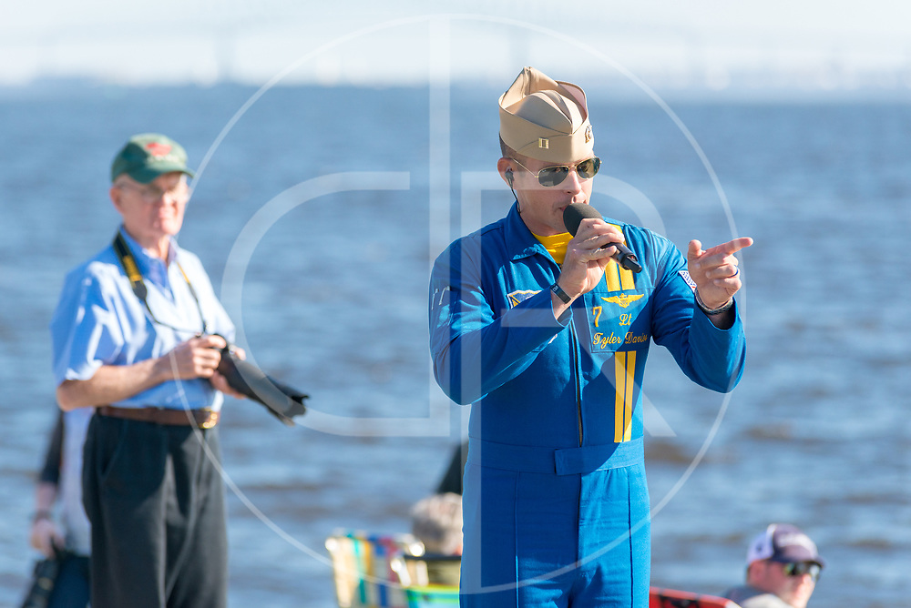 Navy Lt. Tyler Davies of the Blue Angels narrates their performance during their Fleet Week airshow at Fort McHenry in Baltimore, MD
