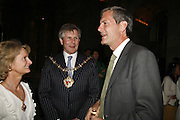 THE MAYOR OF K AND C TIM AHERNE AND MARK JONES, DIR. OF V. & A. Private view for three exhibitions, Sixties Fashion, Sixties Graphics and Che Guevara: Revolutionary and Icon. V&A, 5 June 2006. ONE TIME USE ONLY - DO NOT ARCHIVE  © Copyright Photograph by Dafydd Jones 66 Stockwell Park Rd. London SW9 0DA Tel 020 7733 0108 www.dafjones.com