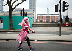 A runner makes their way past the OXO Tower the 2018 London Landmarks Half Marathon. PRESS ASSOCIATION Photo. Picture date: Sunday March 25, 2018. Photo credit should read: Steven Paston/PA Wire