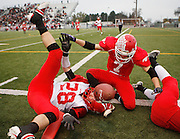 Othello's Juston Lind can't hang onto a pass alongside Prosser's Ethan Hibbs as Prosser defeated Othello 15-14 in a quarterfinal game on Satuday, Nov. 17 at Lampson Stadium in Kennewick.