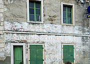 Old faded sign on side of building refering to the long-defunct Communist Party of Jugoslavia. Village of Zrnovo, island of Korcula, Croatia