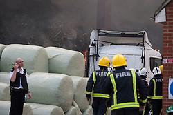 © licensed to London News Pictures. London, UK 12/08/2012. 200 firefighters and 40 fire engines called to a fire incident at a recycling centre on Chequers Lane in Dagenham, east London on 12/08/12. Photo credit: Tolga Akmen/LNP