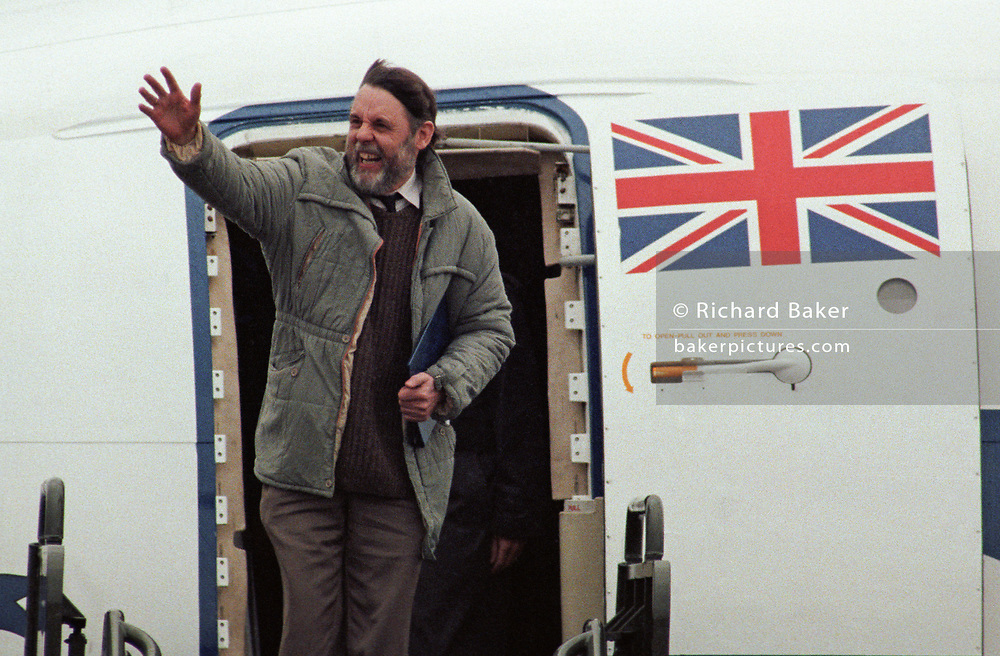 Released hostage Terry Waite waves as he steps out of an RAF aircraft, 5 years after being taken hostage by Jihadists in Lebanon, on 19th November 1991, in Lyneham, England. Terry Waite CBE (born 1939) is an English humanitarian and author who was then Assistant for Anglican Communion Affairs for the then Archbishop of Canterbury, Robert Runcie, in the 1980s. As an envoy for the Church of England, he travelled to Lebanon to try to secure the release of four hostages, including the journalist John McCarthy. He was himself kidnapped and held captive from 1987 to 1991.
